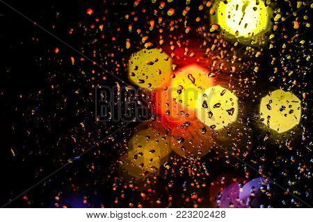 Abstract water drop background, blur and bokeh, raining