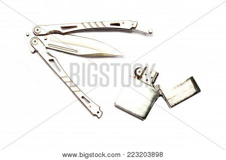 Steel butterfly knife (balisong) ond lighter on a white background