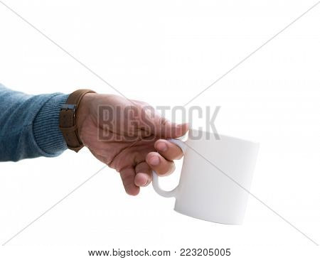 White blank cup mock-up in man's hand. Isolated on white