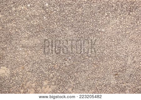 speckled beige cement covered with fine spray of pale beige paint