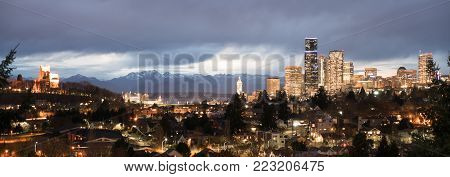 A storm moves over the Olympic Mountains and Puget Sound towards the buildings and architecture of Seattle Washington
