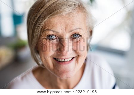 Portrait of a senior woman at home. Close up.