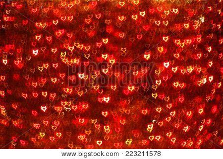 Blurring lights bokeh background of red Devil hearts