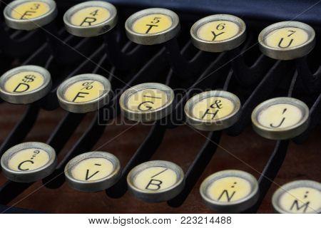 Closeup of the keys of an antique typewriter.