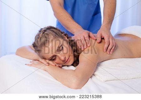 girl masseur doing massage back spa health