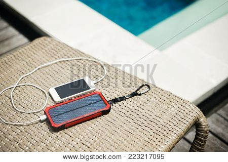Charger on the solar battery. Energy of sun. Paver bank for a smartphone on a solar battery.