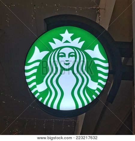 Kuala Lumpur, MALAYSIA - 31 December 2017: A Starbucks company logo attached to the wall of the cafe.