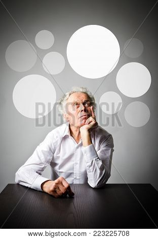 Old man in white is having an idea with gray bubbles over his head. Old man is full of doubts and hesitation.