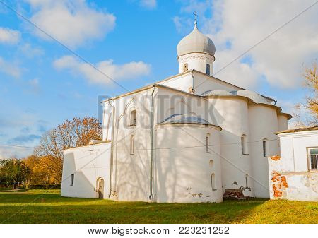 Veliky Novgorod, Russia. Medieval Assumption Church in sunny autumn day at the Yaroslav Courtyard in Veliky Novgorod, Russia