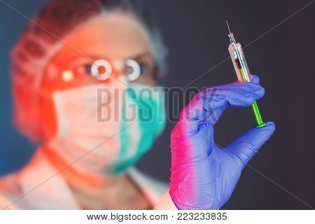 Vaccination is important for immunization. Female medical professional with vaccine syringe