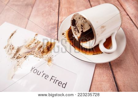 You are dismissed - coffee spilled on an envelope with notice of dismissal