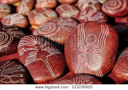 Southern America, Nazca Lines drawn on stones which are being sold in the tourist as souvenirs from Peru