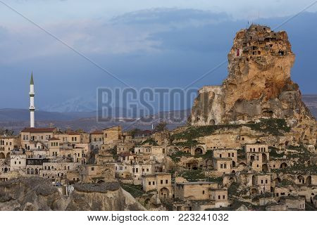View over the old houses and cave dwellings of the town Ortahisar in Cappadocia, Turkey.