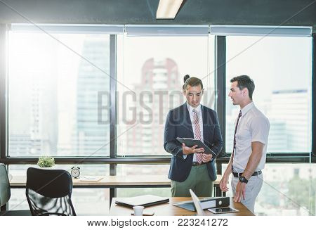 Image of two young businessmen discussing project at meeting.Business presentation.
