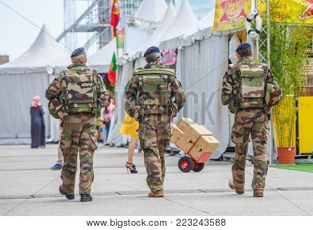 La defense, France - July 17 2016: French military patrol assigned to the surveillance of a business district near Paris. These troops ensure the safety of the citizens and are there in prevention of the terrorist attacks perpetrated in France