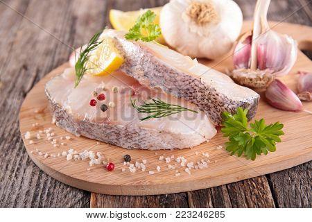 raw fish steak on board