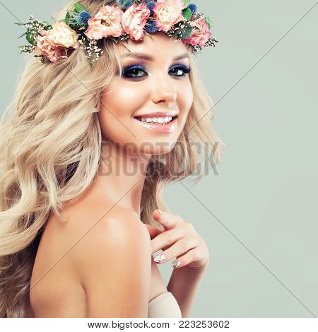Beautiful Blonde Woman Fashion Model with Roses Flowers, Blonde Curly Hairstyle and Healthy Skin. Spring Beauty