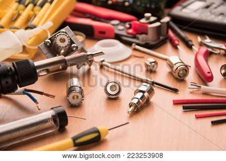 A set of tools for repairing radio, radio parts solder, solder, wires, connectors and screwdrivers poster