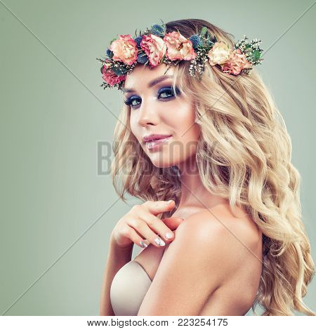 Beautiful Woman with Roses Flowers, Blonde Curly Hairstyle and Healthy Skin on Green Background. Skincare and Haircare Concept