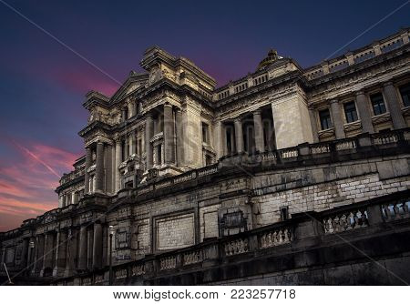 Brussel / Belgium - November 25th 2017 The Palais de Justice (Palace of Justice) standing proud and intimidating on a colorful dusk evening