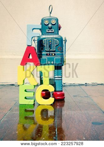 wooden letters fact fake  on wooden floor and retro robot toy