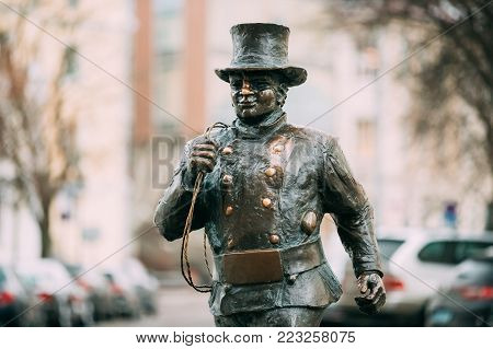 Tallinn, Estonia - December 2, 2016: Bronze Statue Of A Lucky Happy Chimney Sweep With Some Bronze Footsteps Behind Him. Close Up