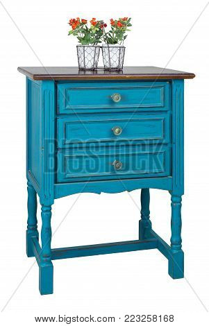 Vintage Furniture - Vintage turquoise commode (Chest of Drawers) with 3 drawers with brass fittings and flower planter isolated on white background including clipping path