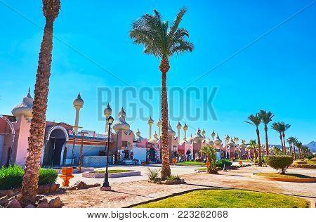 Alf leila wa leila bazaar (1001 nights market) boasts unusual architecture - its modern pavilions imitate the medieval Arabic edifices with beautiful domes, Sharm El Sheikh, Egypt. poster