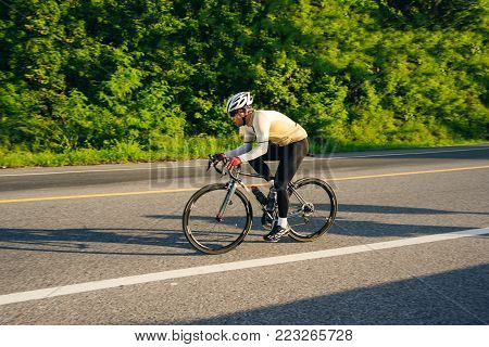Happy Man Cycling Outdoor Exercise Bike Paths In Morning