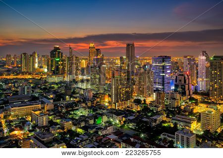 Sunset scence of Bangkok skyline Panorama and Skyscraper ,Aerial view of Bangkok modern office buildings and condominium in Bangkok city downtown with sunset sky and clouds at Bangkok , Thailand.