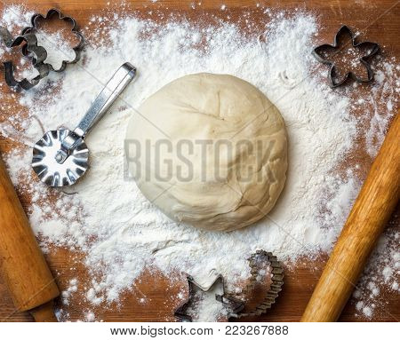 dough on the table with dough tools. forms for squeezing the dough