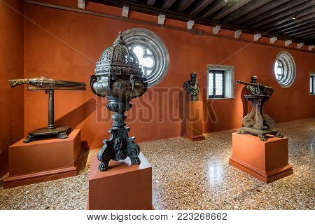 Venice, Italy - May 20, 2017: Inside the Doge`s Palace (Palazzo Ducale), exhibition of medieval things. Doge`s Palace was built in 15th cent on St Mark`s Square and is one of main tourist attractions of Venice.