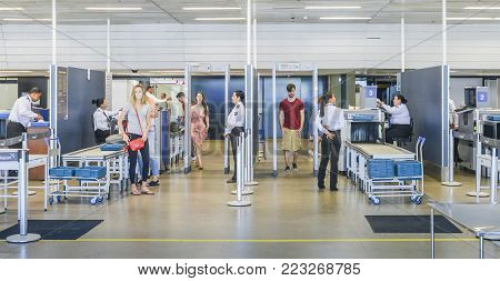 Santos Dumont Airport, Rio de Janeiro, Brazil - Dec 22, 2017: Passenger and their belongings are inspected at a security check prior to boarding at Rio de Janeiro's Santos Dumont airport