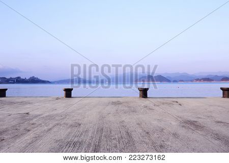 emtpy concrete floor and beautiful qiandao lake in foggy sky