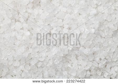 Coarse salt macro background texture. Top view