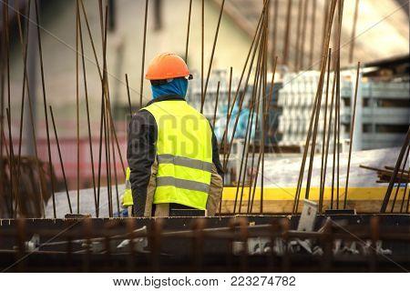 Builder in orange helmet at the construction site