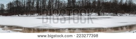 The frozen river in the park, panoramic shot