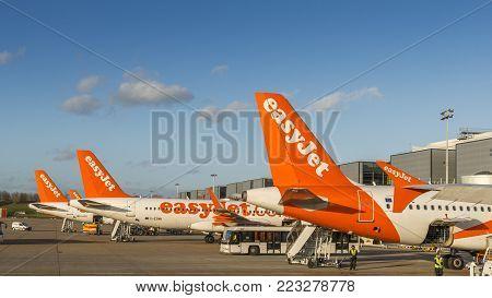 London Gatwick, UK - Nov 23rd, 2017:  Easyjet airplanes and airport personnel at London's Gatwick airport - South Terminal