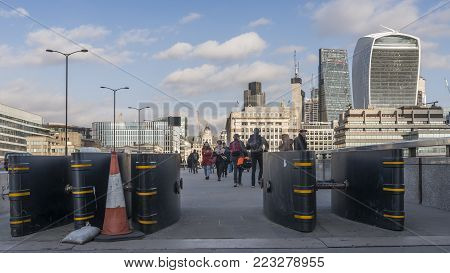 London, UK - November 22nd, 2017: Anti-vehicle barriers erected on the pavement on London Bridge in the Borough area, Southwark, London SE1 as a terrorism prevention measure