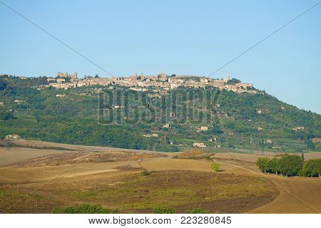 TUSCANY, ITALY - SEPTEMBER 26, 2017: September landscape with the city of Montalchino in the sunny day