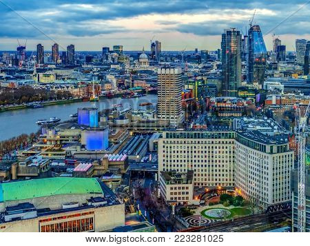 LONDON, ENGLAND - NOVEMBER 28, 2017: Aertial view at oane part of city, at dusk time, from London Eye capsule. Giant Ferris wheel on the Bank of the River Thames has 135 m tall and 120 m in diameter.