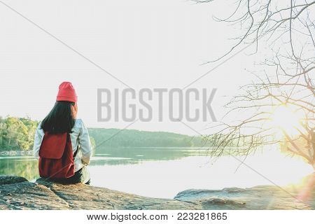 Beautiful Black Hair Woman Enjoying On The Stone Patio In Front Of Lake. Pretty Girl Relaxing Outdoo