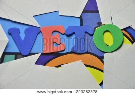 word veto  on an   abstract colored background