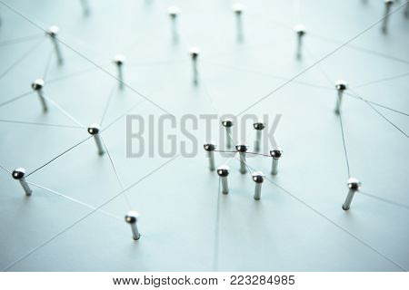 Connecting people, machies and minds.Networking, social media, SNS, internet infrastructure communication abstract. Small or private network connected to a social network. Web of silver or chrome wire