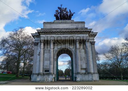 Wellington Arch or Constitution Arch is a triumphal arch located to the south of Hyde Park in London. Dramatic cloudy sky