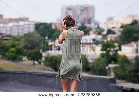 Roof woman alone stress walk concept. reluctance to hear. deaf to others problems