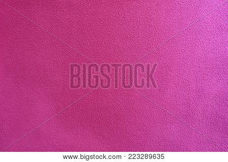 Cerise colored polar fleece fabric from above