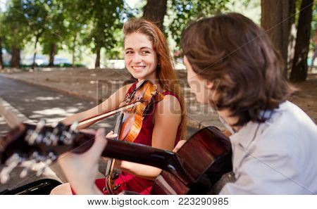 street musician romantic date. duet performance. couple love playing instruments together. art creation inspiration concept