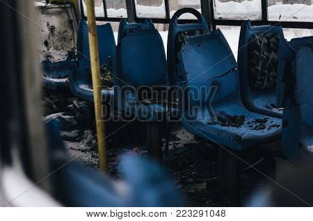 The Abandoned Passenger Bus After The Explosion. Inside, You Can See Broken Armchairs And Broken Gla