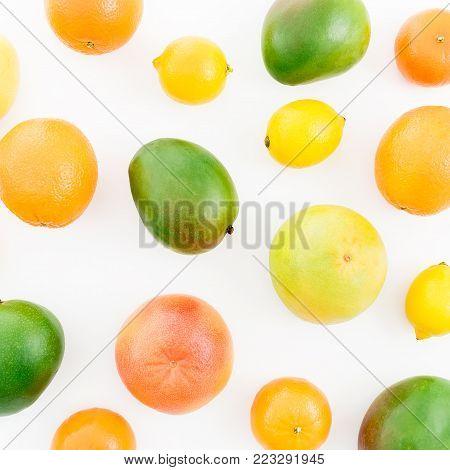 Fruit's background. Fruits - lemon, orange, grapefruit, sweetie and mango isolated on white background. Flat lay, top view.